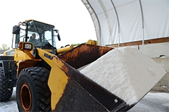 Driver Glenn Longenecker loads bulk salt into his truck for delivery to a commercial customer of Lancaster County-based The Cope Company Salt, supplier of commercial salt and brine. Photo/Amy Spangler