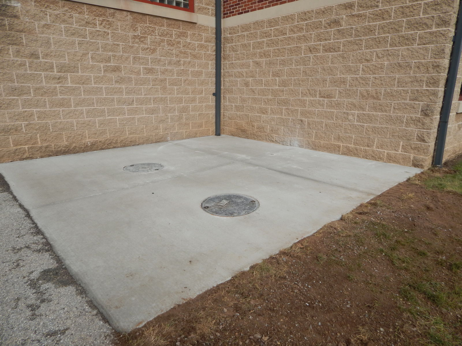 concrete pad with manhole cover